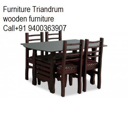 Glass top dining set From furniture trivandrum